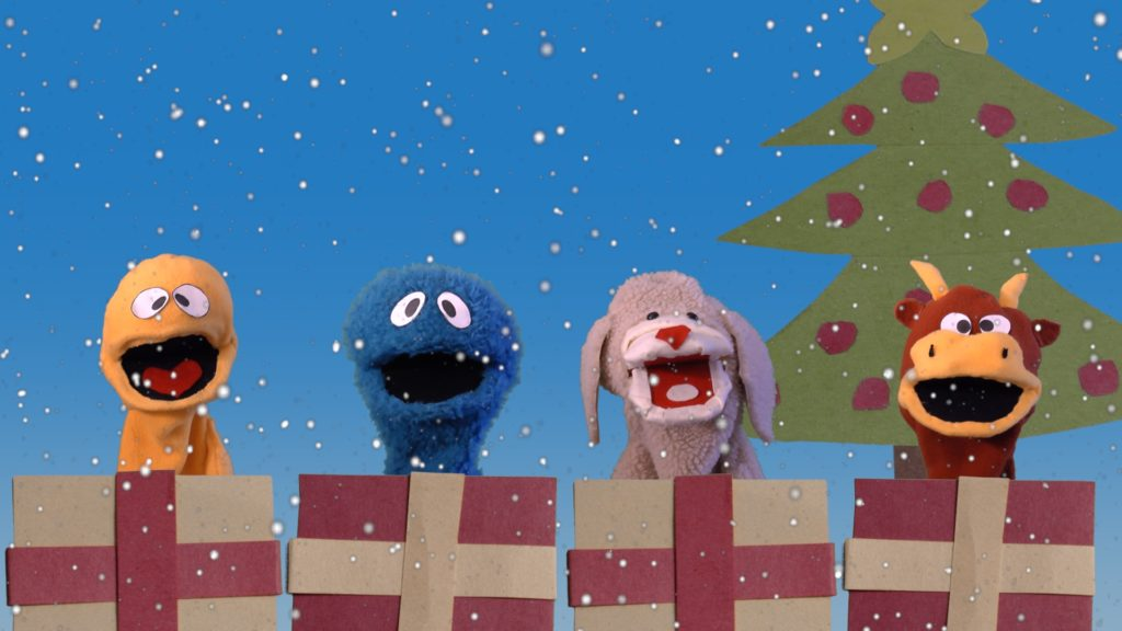 Four puppets popping out of gift boxes